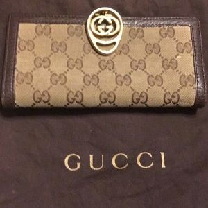 Vintage Gucci wallet with gold GG clasp